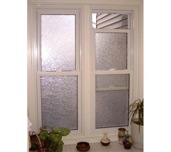Privacy glass for bathroom by Smart Windows Colorado